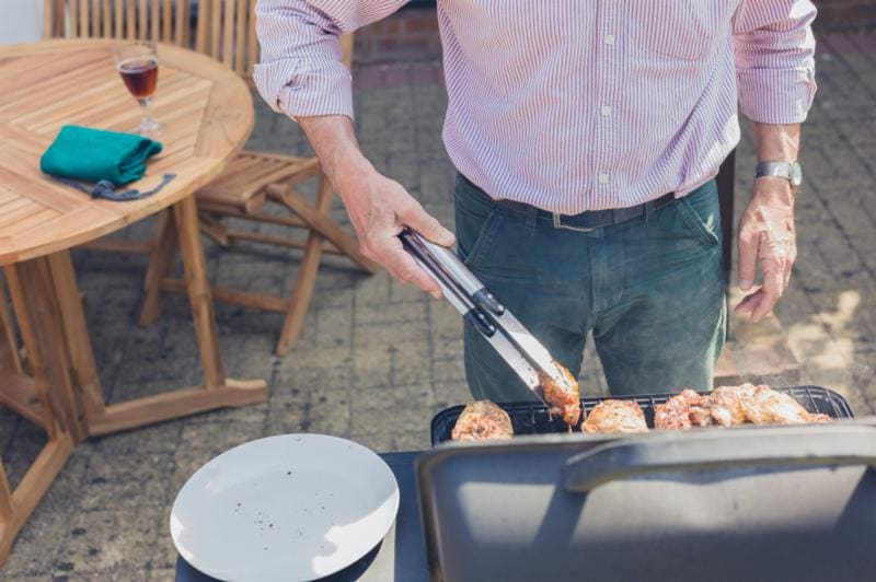 image of man grilling
